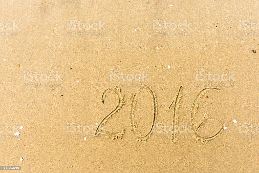 2016 Year written on the beach sand stock photo