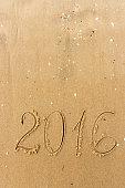 2016 Year written on the beach sand