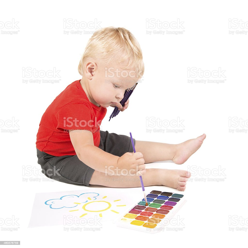 year-old child during painting a sun by brush and watercolours royalty-free stock photo