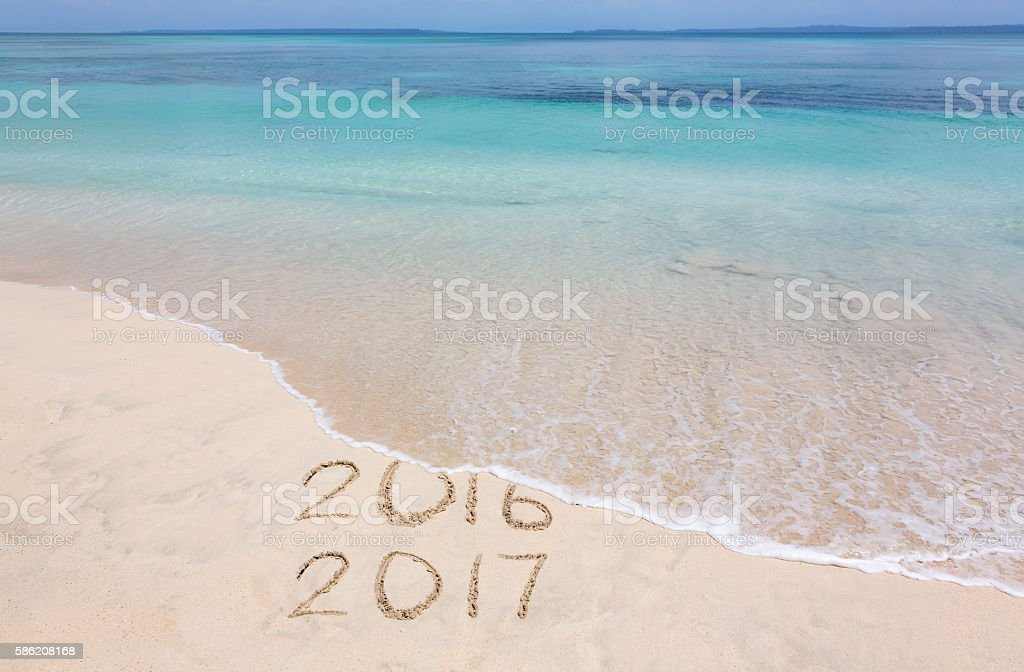 Years 2016 and 2017 on the beach stock photo
