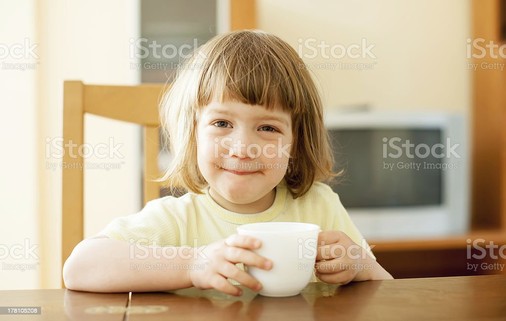 2 years child drinking from cup stock photo