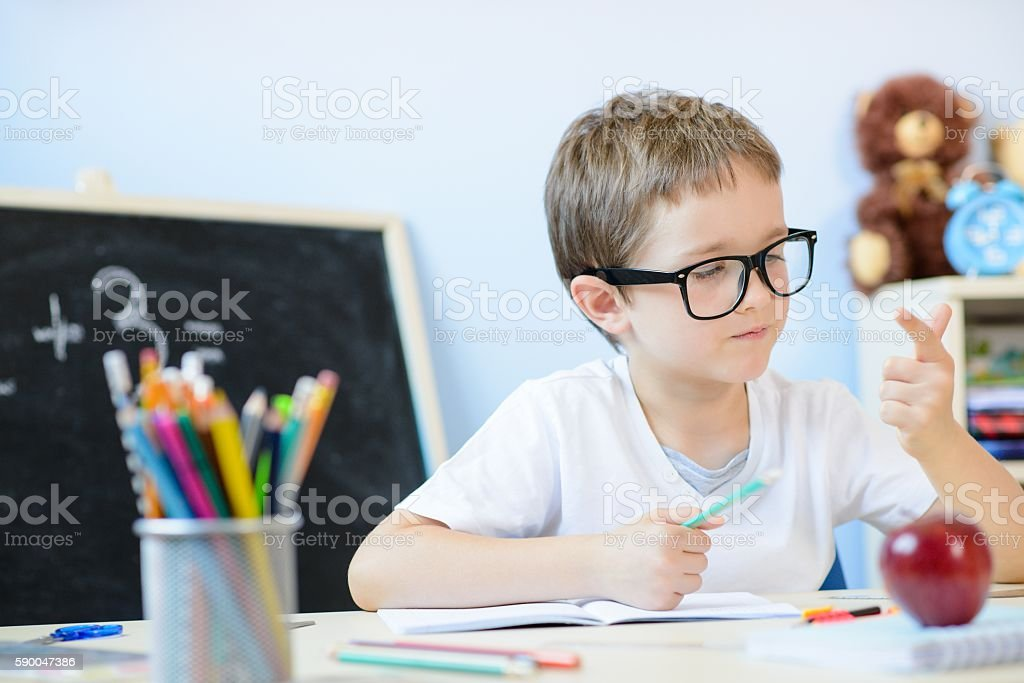7 years old boy counting on fingers. stock photo