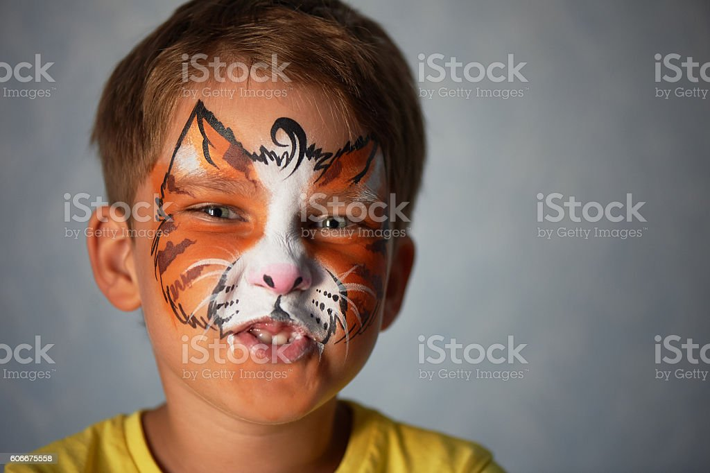 years old boy with blue eyes  face painting of a stock photo