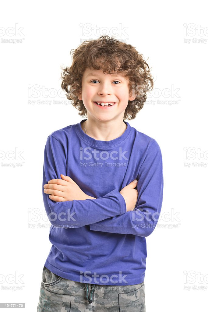 8 years old boy with curly hair stock photo