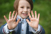 5 years old boy with dirt on his hands