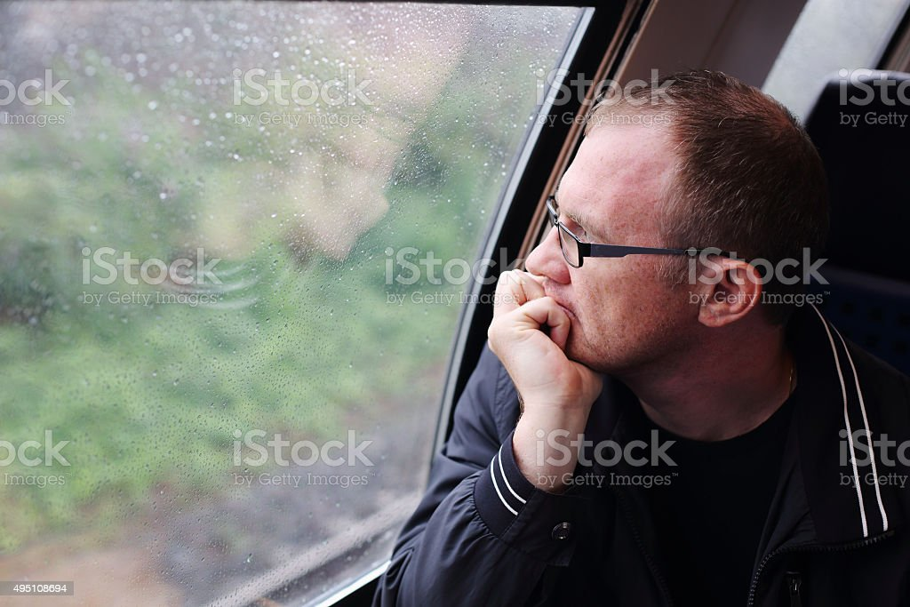 40 years old man looking to the window stock photo