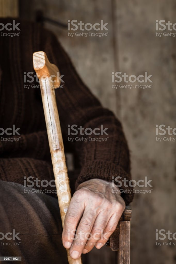 87 years old man sitting in front of old village house stock photo