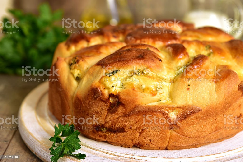 Yeast cake with feta and greens. stock photo