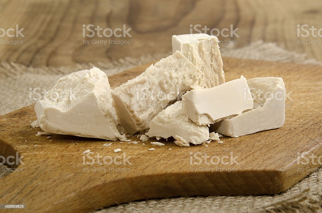 yeast cube on a wooden board stock photo