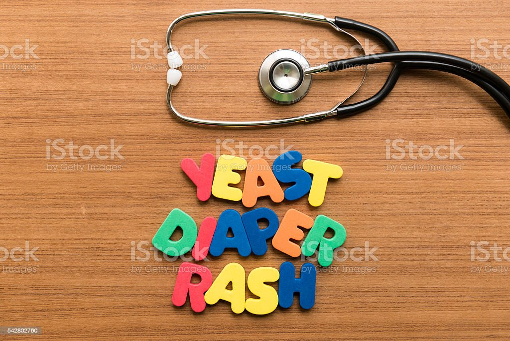 yeast diaper rash colorful word with stethoscope stock photo