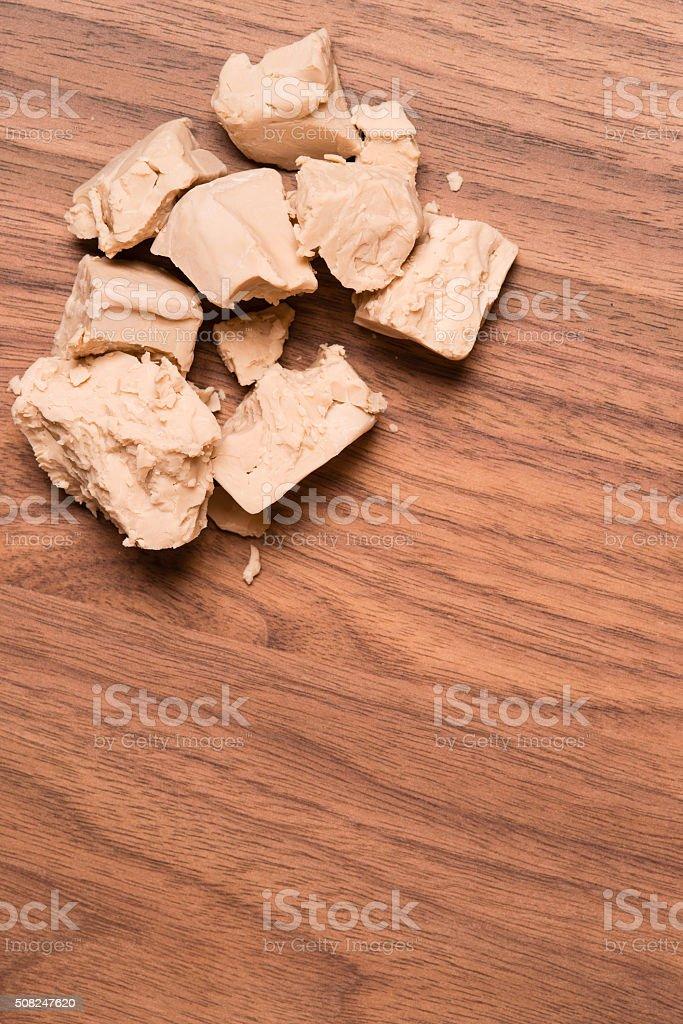 Yeast on walnut table stock photo
