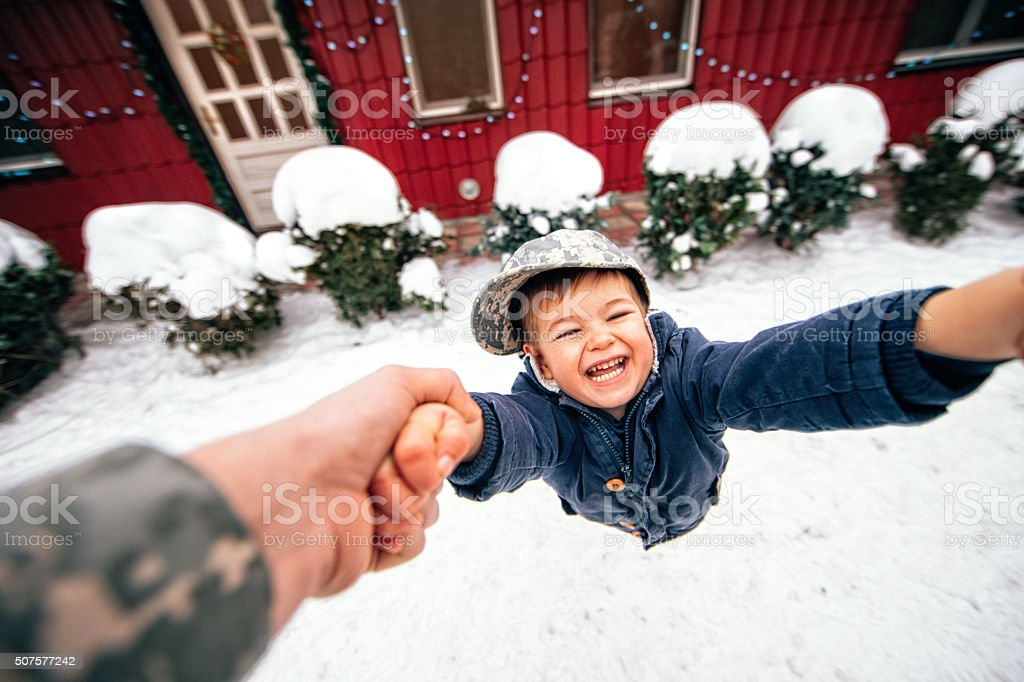 Yeeey, daddy's home for holidays! stock photo