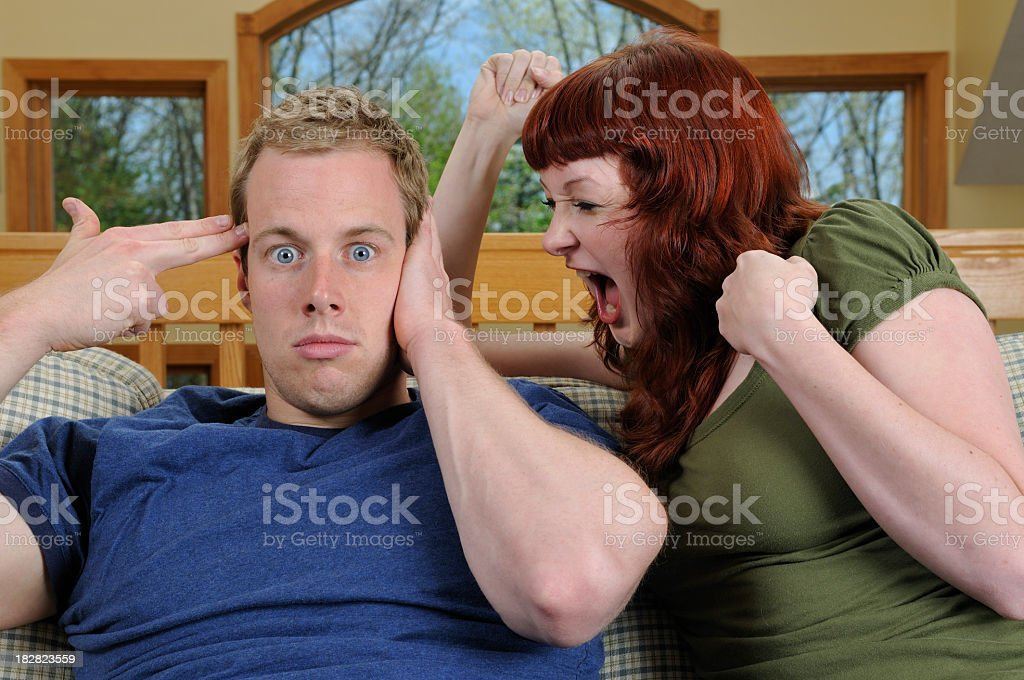 Yelling in Ear royalty-free stock photo