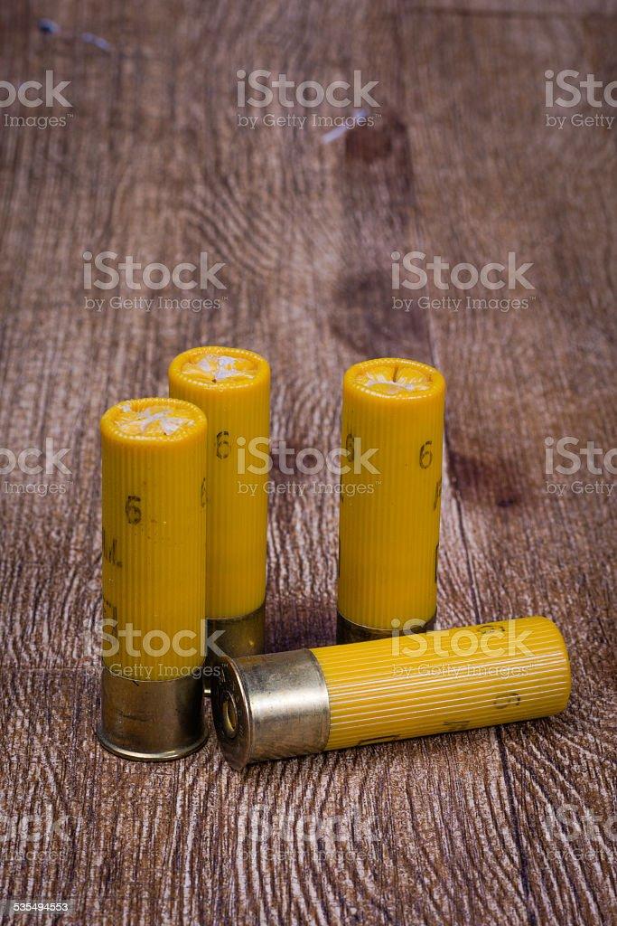Yellow 20 gauge shotgun shells stock photo