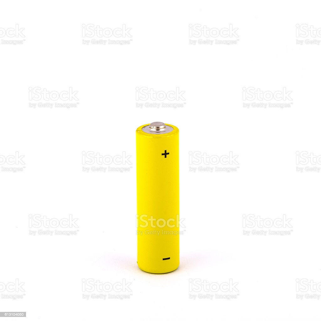 Yellow AA battery on white background stock photo