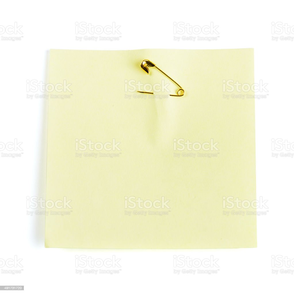 Yellow adhesive note attached with safety pin stock photo