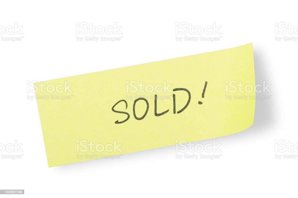 Yellow adhesive note 'sold' (with clipping path) royalty-free stock photo