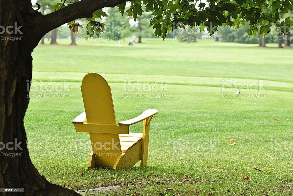 yellow adirondack chair royalty-free stock photo