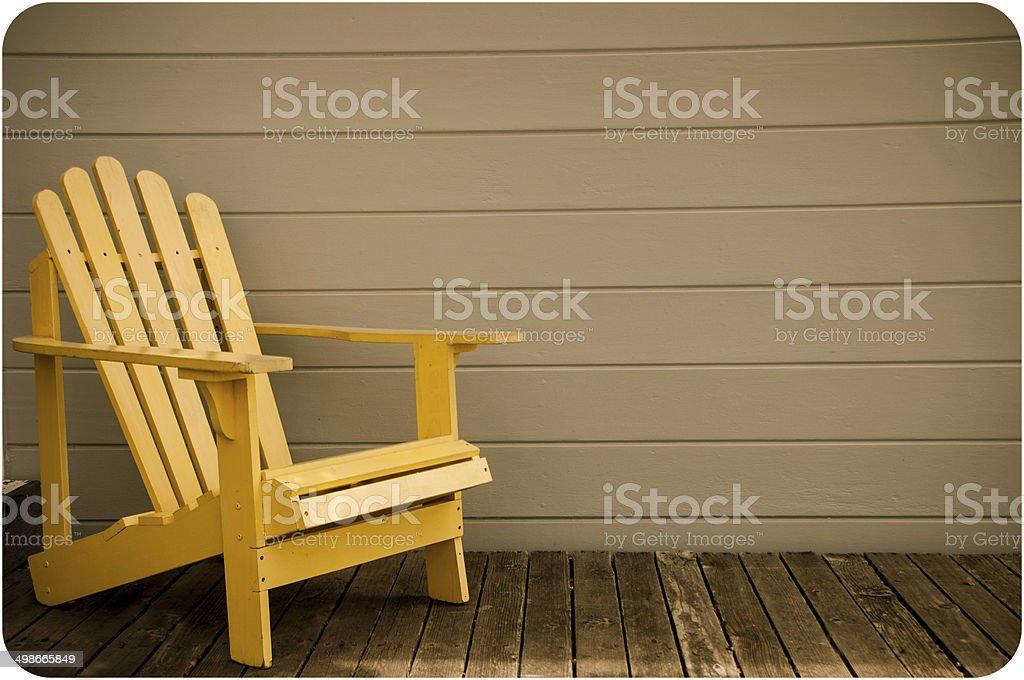 Yellow Adirondack Chair stock photo