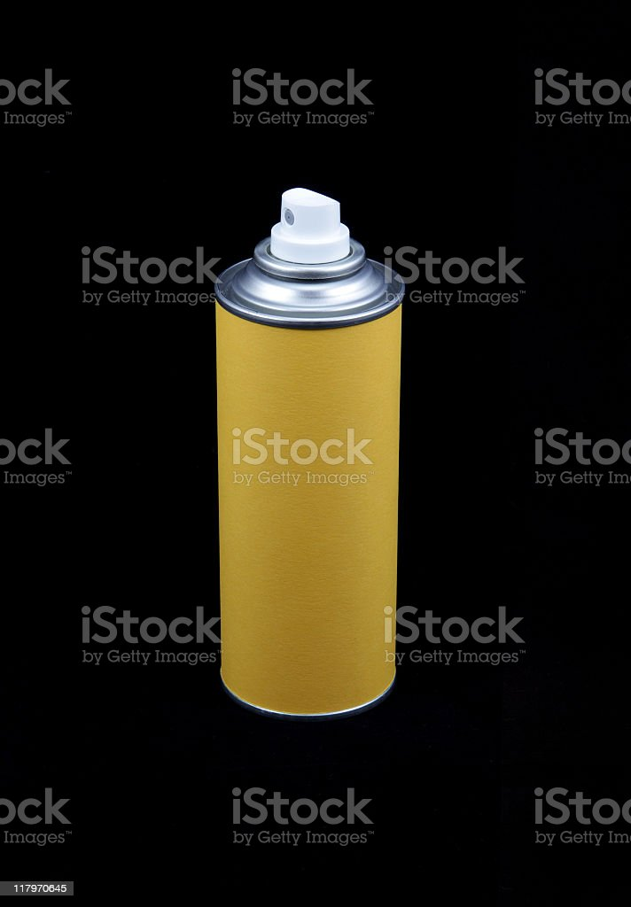 yellow aerosol can on black background stock photo