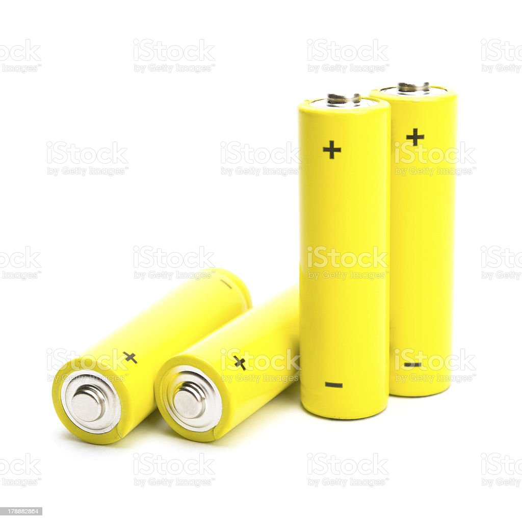 yellow alkaline batteries isolated on white background royalty-free stock photo