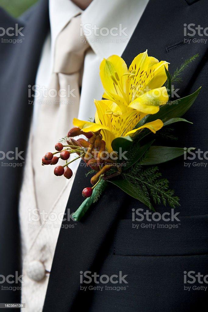 Yellow Alstromeria Corsage on Groomsman stock photo