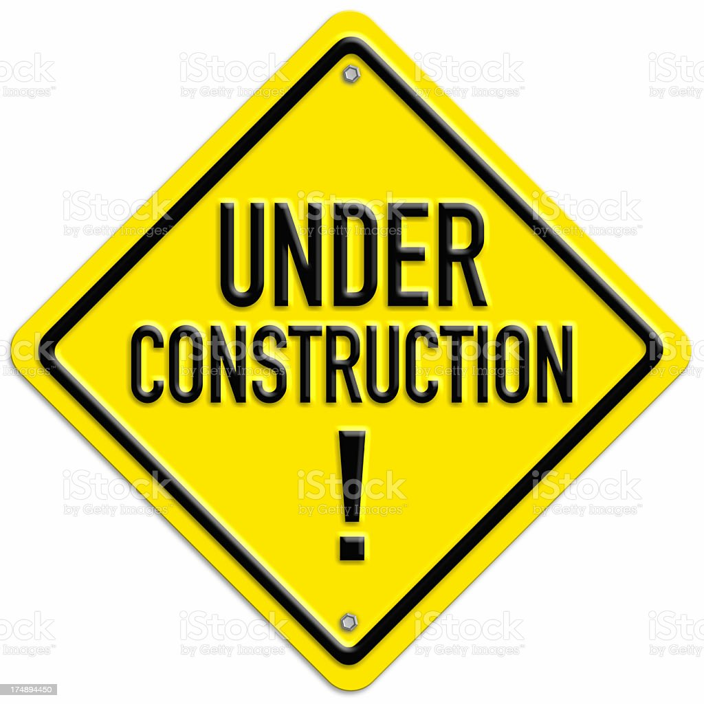 Yellow and black diamond shaped under construction sign stock photo