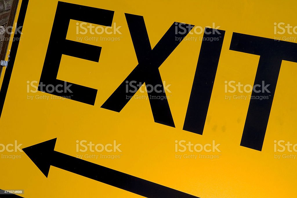 Yellow and black exit sign with arrow royalty-free stock photo
