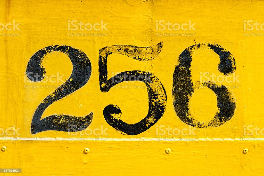 Yellow and black number 256 stock photo