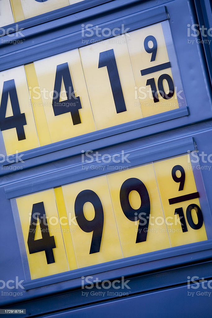 Yellow and Black Sign Showing Inflated Gas Prices royalty-free stock photo