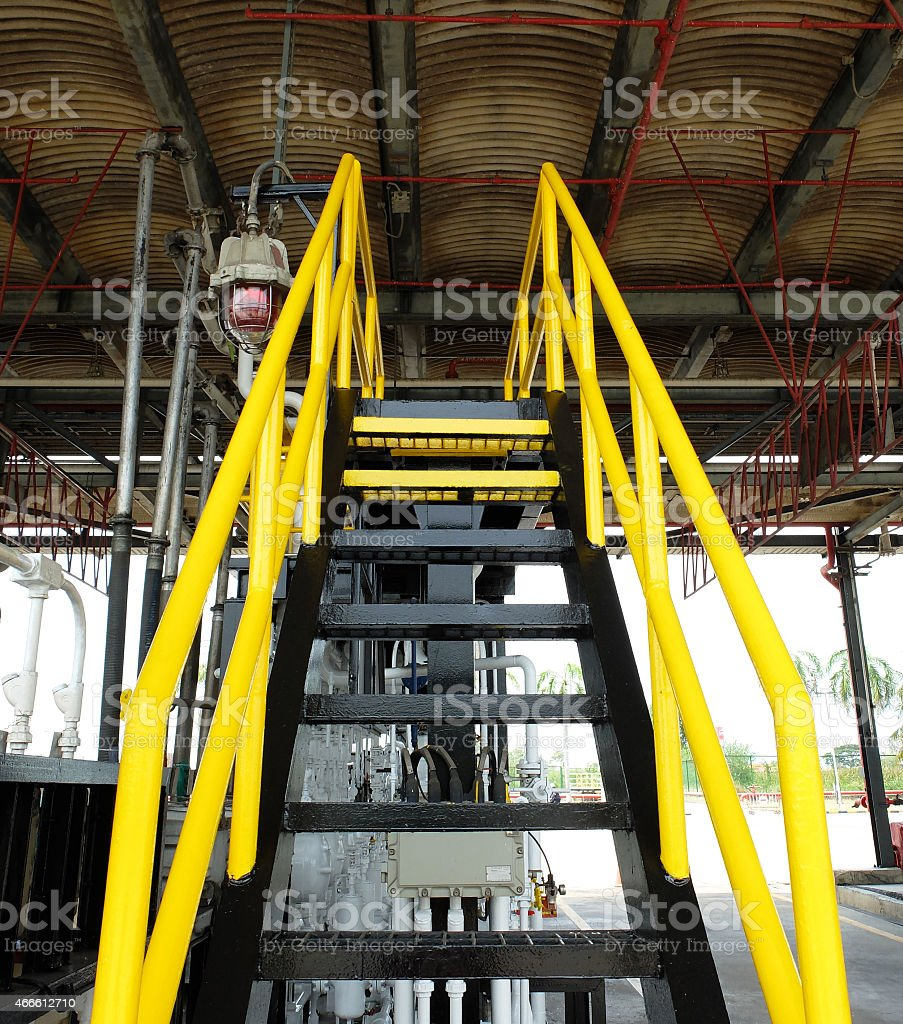Yellow and Black Stair in Fuel Terminal stock photo