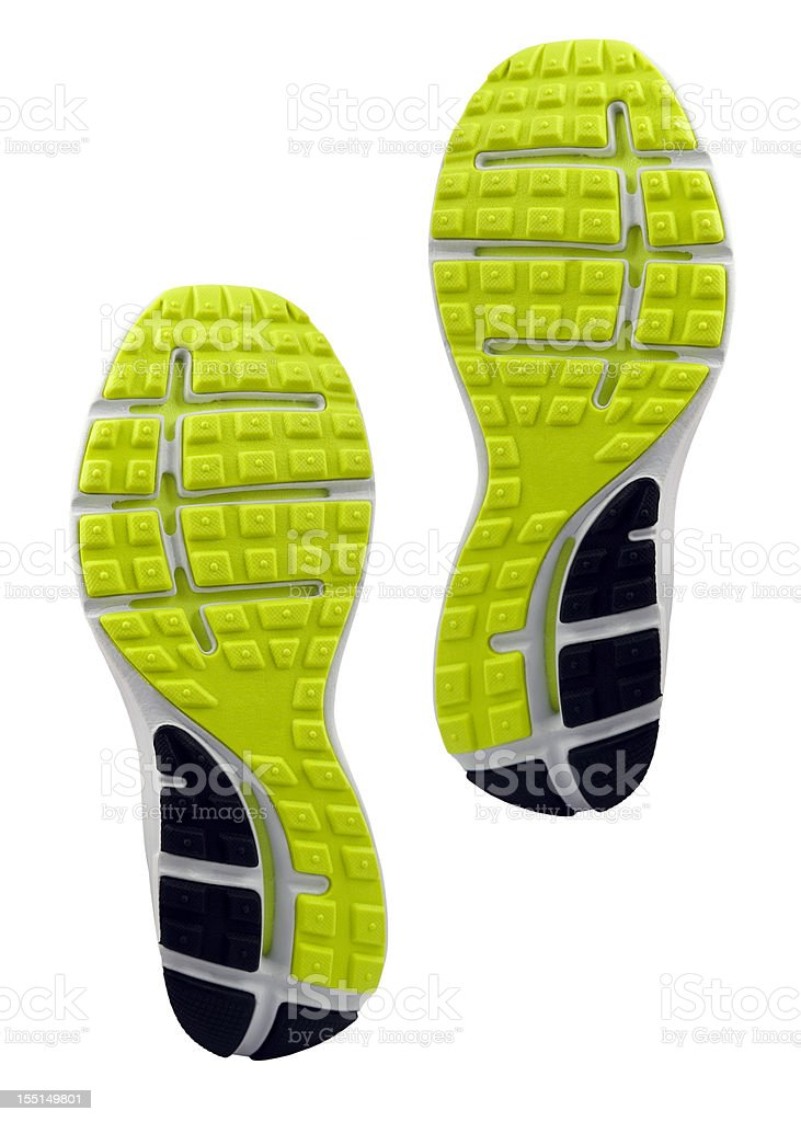 Yellow and black treaded soles of athletic shoes stock photo