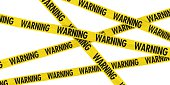 Yellow and Black WARNING Barrier Tape Background