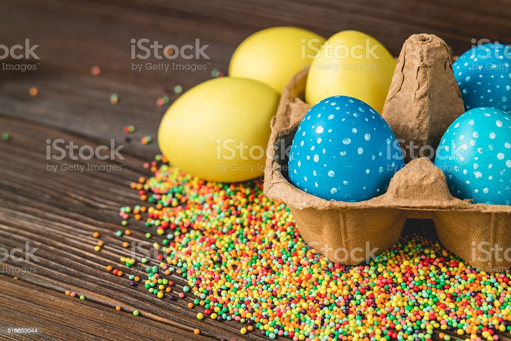 Yellow and blue easter eggs in a box stock photo