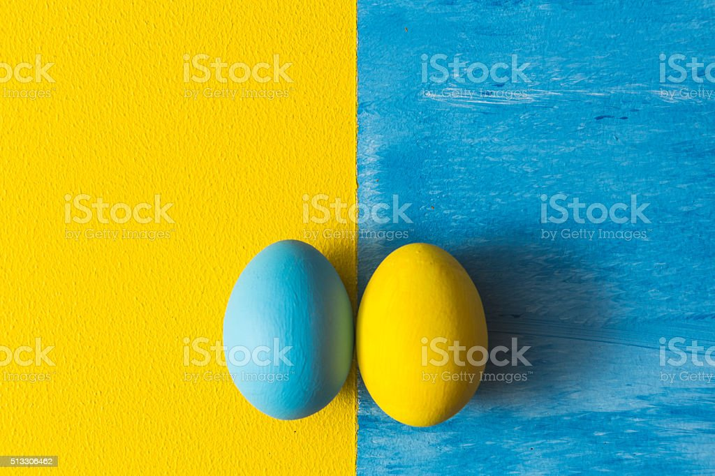 Yellow and blue eggs stock photo