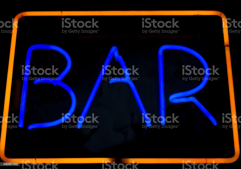 Yellow and Blue Neon Sign Advertising 'BAR' stock photo