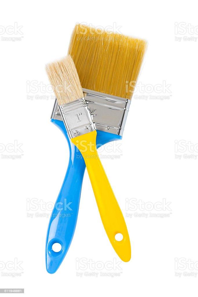 yellow and blue paintbrushes isolated stock photo