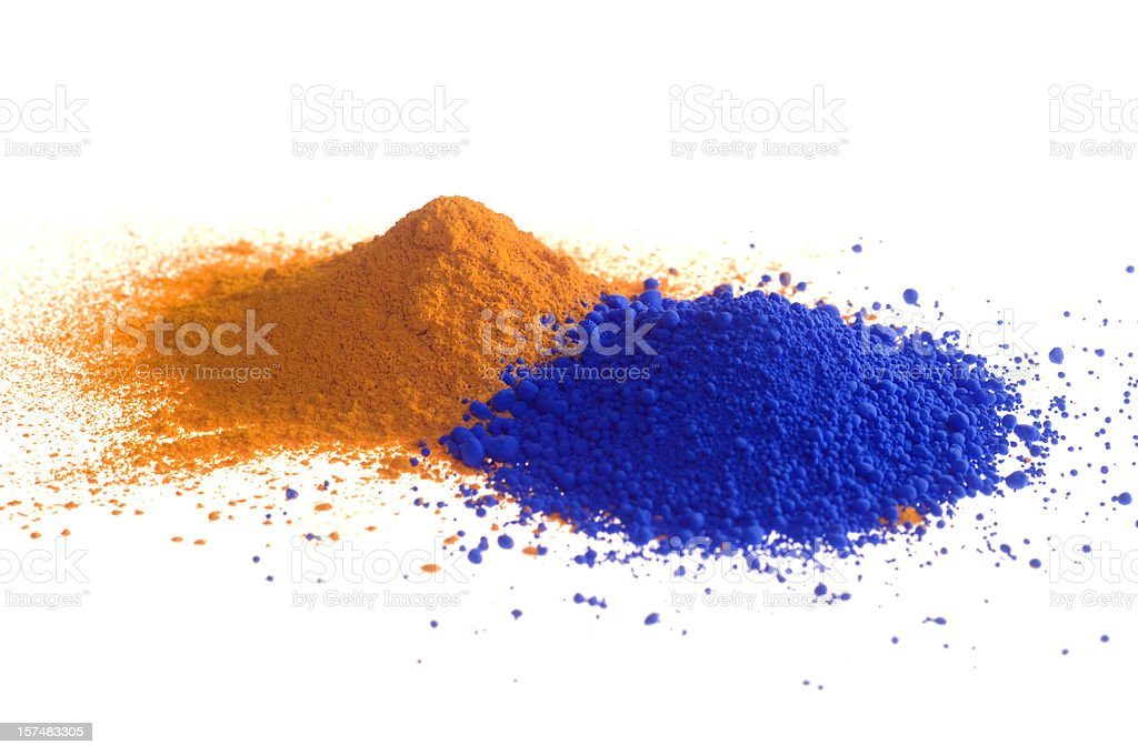 Yellow and blue piles of pigment powder on white royalty-free stock photo