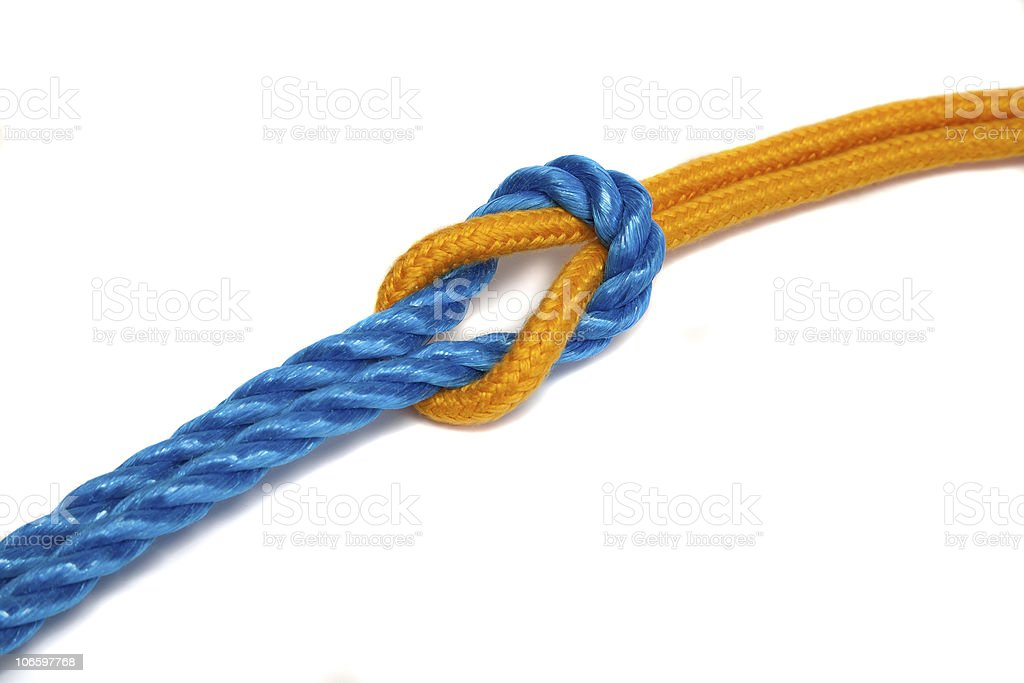 Yellow and Blue Ropes tied together with a reef knot stock photo