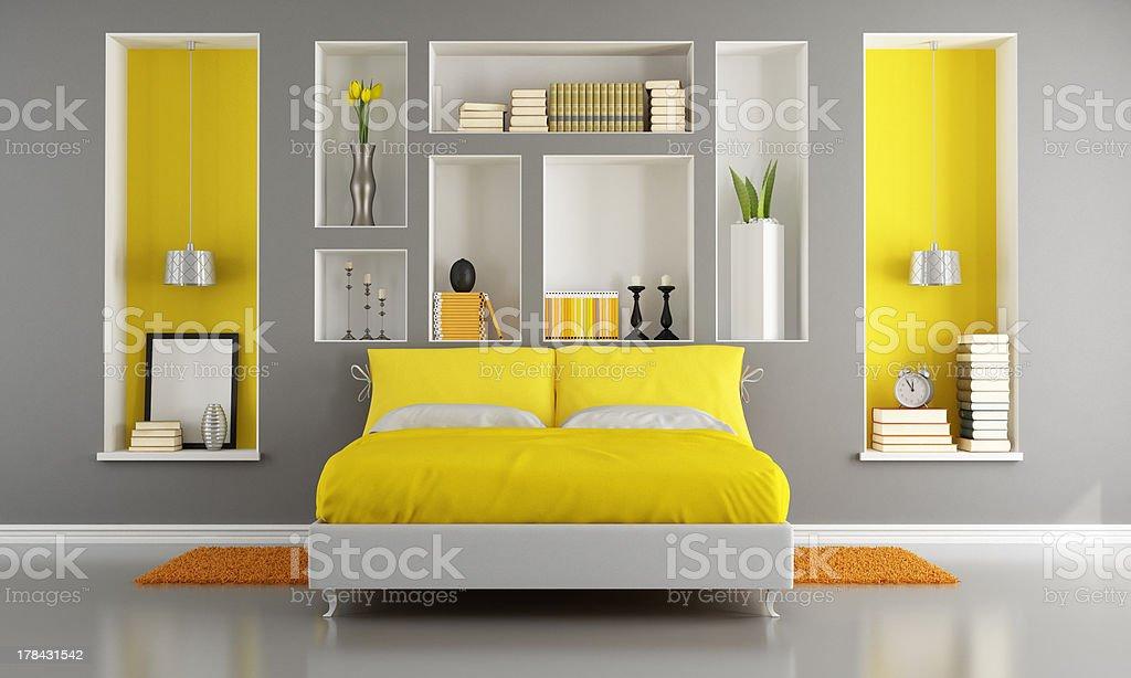 Yellow and gray modern bedroom stock photo