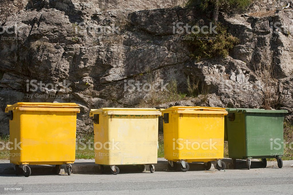 Yellow and  green garbage bins for recycling. stock photo