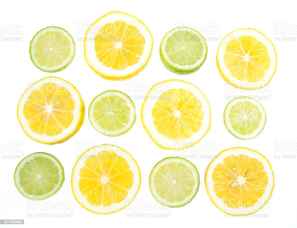 Yellow and green lemon and lime slices on white background stock photo