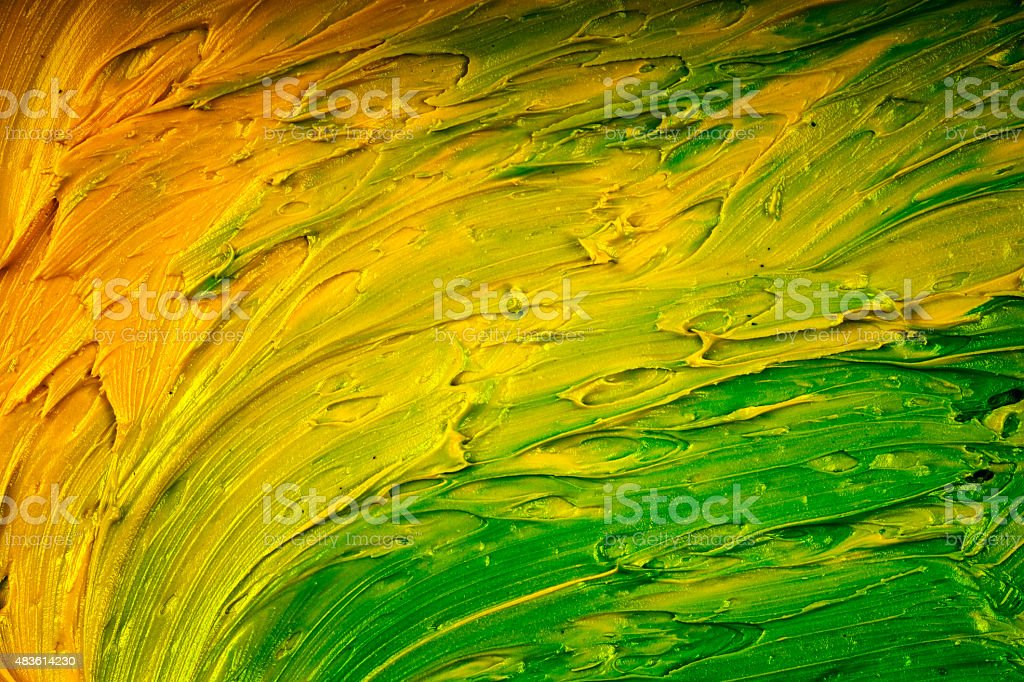 Yellow and Green Paint Mixed make a Swirl Vibrant Colour stock photo