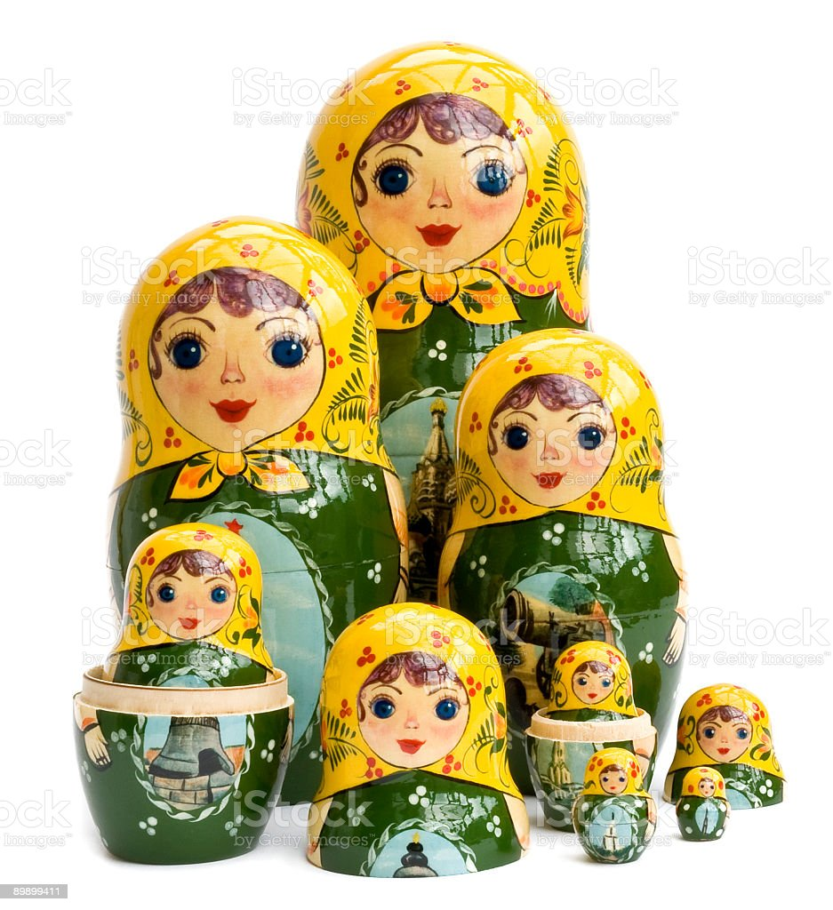 Yellow and green Russian nested dolls sitting in a group royalty-free stock photo