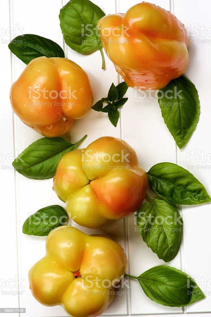 Yellow and Orange Bell Peppers stock photo