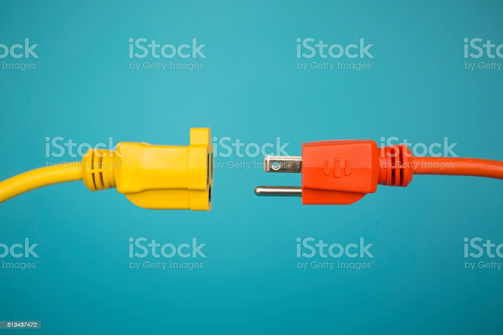 Yellow and Orange electric plug stock photo