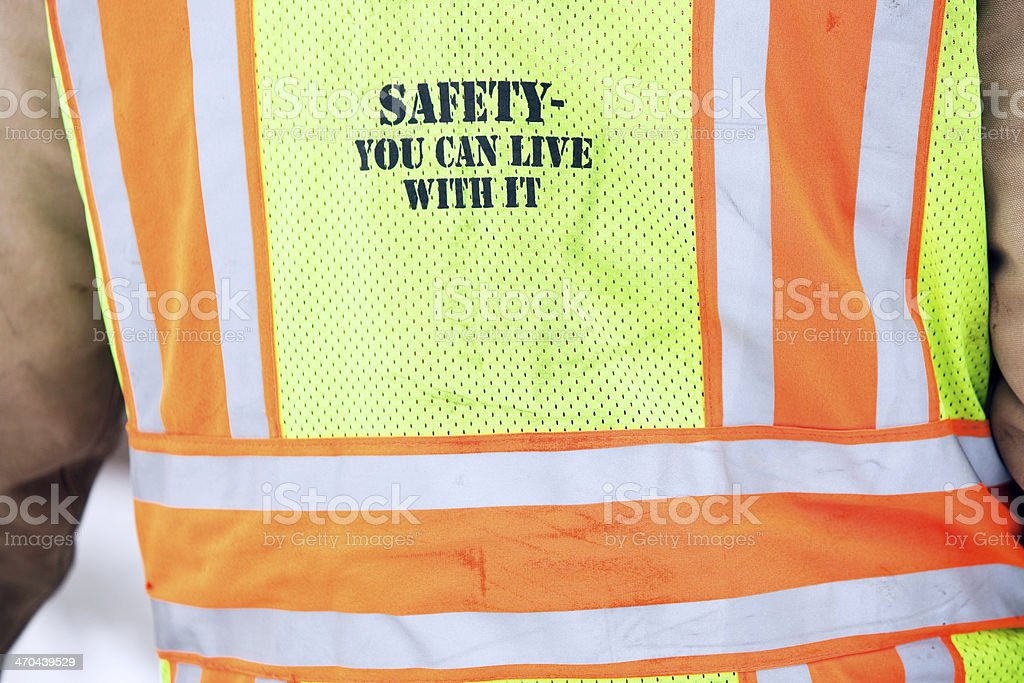 Yellow and Orange Safety Vest with Reflective Strips royalty-free stock photo