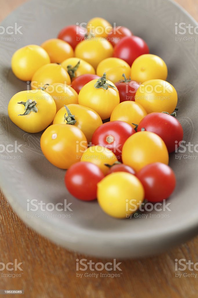 Yellow and red cherry tomatoes royalty-free stock photo