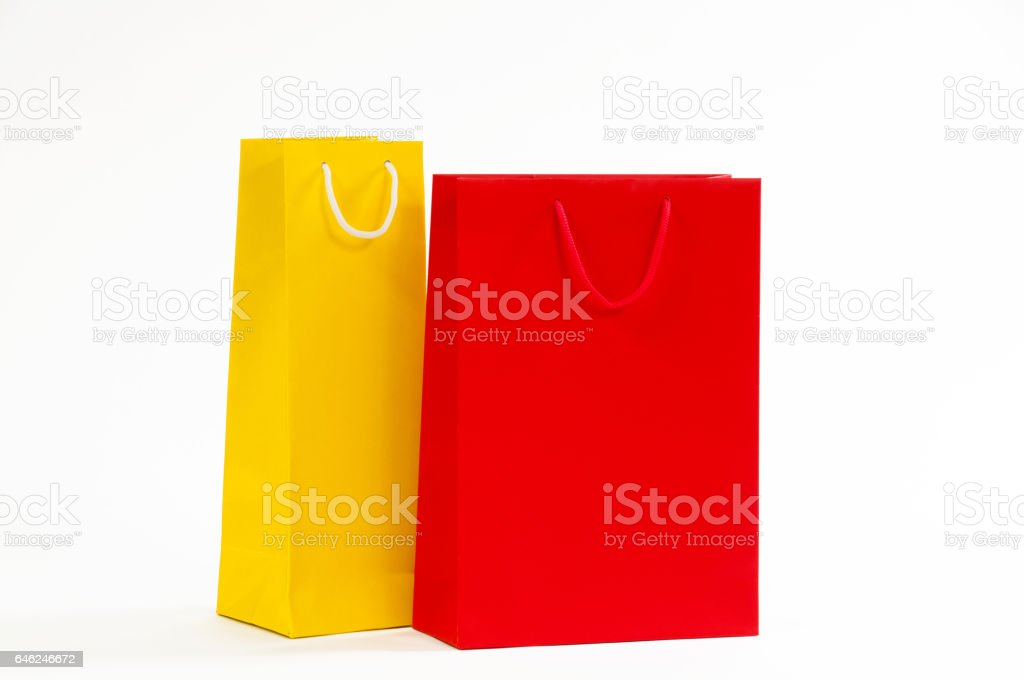 Yellow and red paper bag on a white background. stock photo