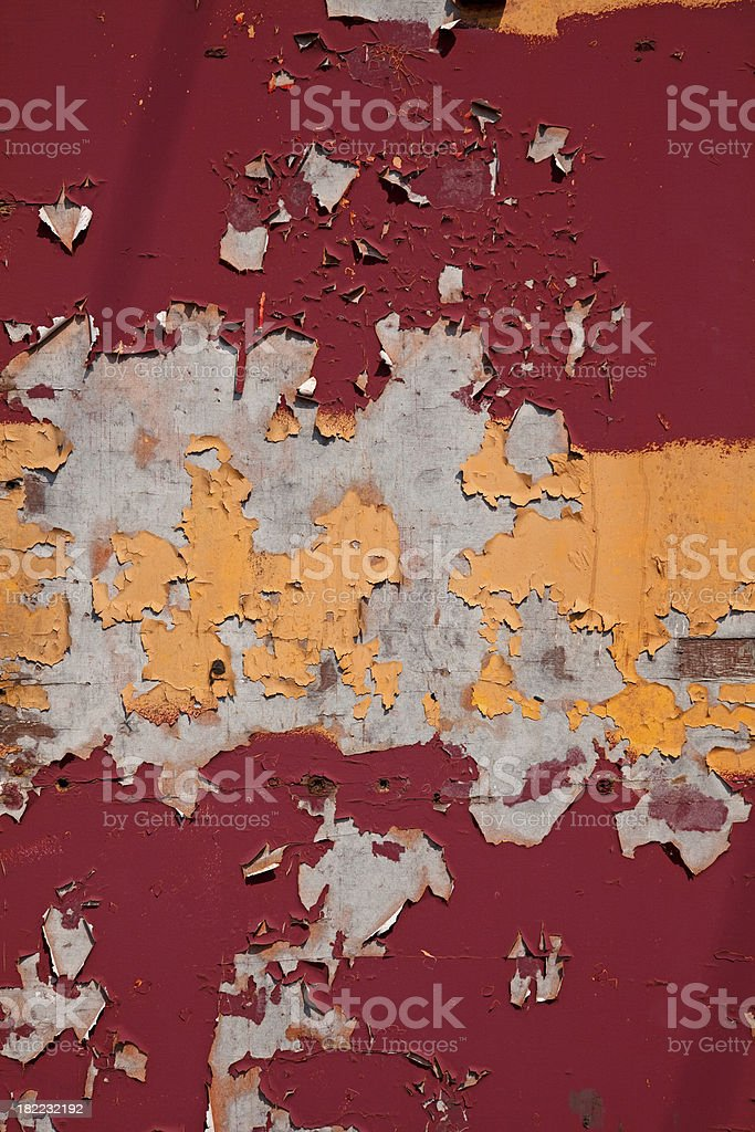 Yellow and red Peeling Paint Background texture on metal wall stock photo